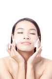 Beautiful woman washing her beauty face with clean Stock Images