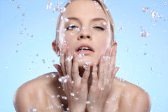 Beautiful woman washing her face Stock Photos