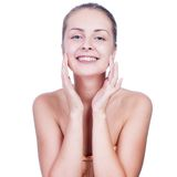 Beautiful woman washing her face Royalty Free Stock Image