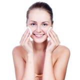 Beautiful woman washing her face Stock Photos