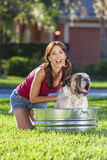 Beautiful Woman Washing Her Pet Dog In A Tub royalty free stock photography