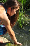 Beautiful woman washing at the river Stock Images