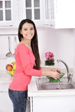 Beautiful woman washing strawberry Royalty Free Stock Images