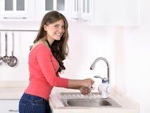 Beautiful woman washing strawberry Stock Images