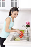 Beautiful woman Washing vegetables Royalty Free Stock Images