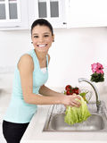 Beautiful woman Washing vegetables Stock Images
