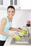 Beautiful woman Washing vegetables Stock Photography