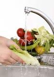 Beautiful woman Washing vegetables Stock Photo