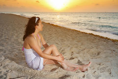 Beautiful woman watching sunrise Stock Photo