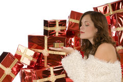 Beautiful woman watching a tiny present Royalty Free Stock Photos