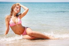 Beautiful woman in water Stock Images