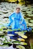 Beautiful woman  and water Stock Image