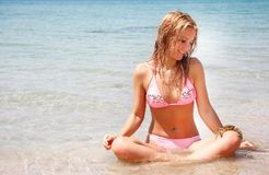 Beautiful woman in water with crab Royalty Free Stock Image