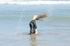 Beautiful woman in the water from the ocean Royalty Free Stock Photography