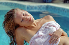 Beautiful woman before water pool Stock Image