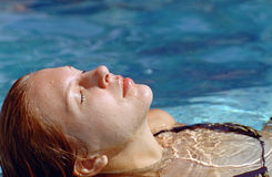 Beautiful woman in water pool royalty free stock photos