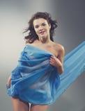 Beautiful woman in  waving fabric. Stock Photo