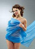 Beautiful woman in  waving fabric. Stock Photography