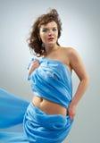 Beautiful woman in  waving fabric. Royalty Free Stock Photos