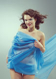 Beautiful woman in  waving fabric. Royalty Free Stock Image
