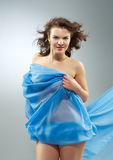 Beautiful woman in  waving fabric. Royalty Free Stock Photography