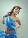 Beautiful woman in  waving fabric. Royalty Free Stock Photo