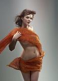 Beautiful woman in  waving fabric. Royalty Free Stock Photography