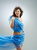 Beautiful woman in  waving fabric. Stock Images