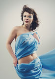 Beautiful woman in  waving fabric. Royalty Free Stock Images