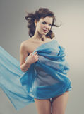 Beautiful woman in  waving fabric. Stock Photography