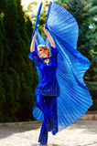 Beautiful woman. Waving fabric wings. Toned image Stock Images