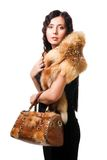 Beautiful woman wear fur with purse Royalty Free Stock Photography