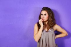 Beautiful woman wearing beige dress and lilac glit Royalty Free Stock Image