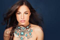 Beautiful woman wearing big glamorous necklace royalty free stock image