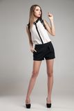 Beautiful woman wearing blouse and shorts Stock Photography