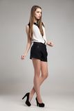 Beautiful woman wearing blouse and shorts Royalty Free Stock Photo