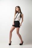 Beautiful woman wearing blouse and shorts Royalty Free Stock Photos