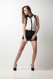 Beautiful woman wearing blouse and shorts Stock Photography