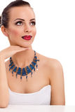 Beautiful woman wearing blue necklace Stock Photography