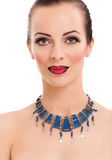 Beautiful woman wearing blue necklace Stock Image