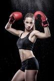 Beautiful woman wearing boxing gloves Stock Photo
