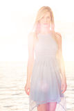 Beautiful Woman Wearing Casual Dress Standing Against Sea In Bac Stock Images