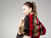 Beautiful woman wearing colorful kashmir scarf  on grey Royalty Free Stock Image