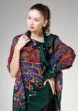 Beautiful woman wearing colorful kashmir scarf Stock Image