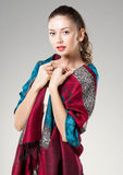 Beautiful woman wearing colorful kashmir scarf Royalty Free Stock Photography