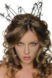Beautiful woman wearing crown of barbed wire Stock Images