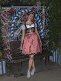 Woman in dindl at the Oktoberfest. A beautiful woman wearing a dirndl is posing at the Oktoberfest of Munich, Germany stock photo