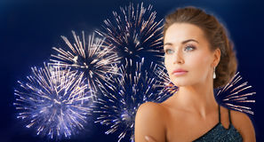 Beautiful woman wearing earrings over firework Royalty Free Stock Images