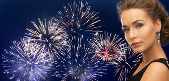 Beautiful woman wearing earrings over firework Royalty Free Stock Photos