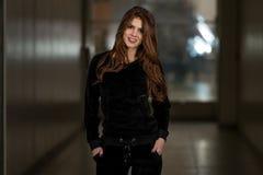 Beautiful Woman Wearing Fashion Tracksuit In Black Stock Photos